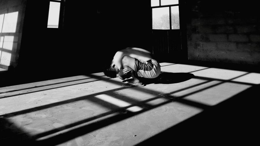 Depressed Man Crouching In Prison
