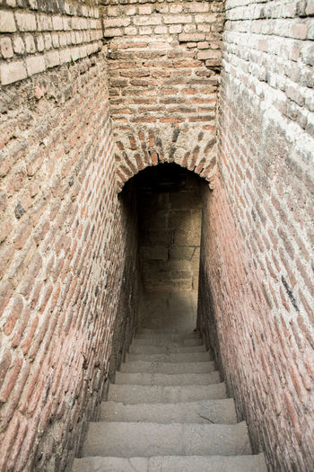 History Ancient Civilization Architecture Built Structure Passageway Stone Wall Entryway Fort Narrow Passage Entrance Fortified Wall Entry Fortress Wall Historic Arch Castle Arched Archway Open Door Closed Door Cannon