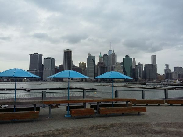 Blue Umbrellas. · New York City New York NYC Brooklyn Manhattan Backdrop Cityscape Skyline Urban Urban Landscape Solitude Minimalism Gray Sky Cloudy Day Clouds And Sky