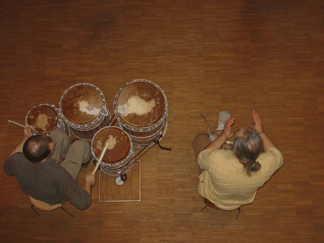 two men playing djembe African Arts Culture And Entertainment Bongo Casual Clothing Caucasian Clapping Hands Djembe Drum Drum - Percussion Instrument Drummer Drumming Drums Drumsticks High Angle View Indoors  Instrument Men Music Musician People Percussion Performance Playing Rhythm Two People