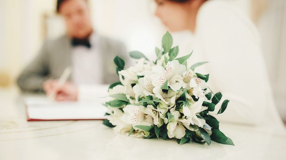 Wed Flower Bride Wedding Indoors  Bouquet Celebration Wedding Ceremony Life Events Real People Wedding Dress Groom Women Bridegroom Celebration Event Focus On Foreground Men Rose - Flower Love Table Ceremony
