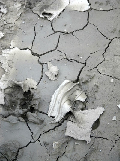 Caked mud. Arid Climate Backgrounds Close-up Cracked Day Dried Mud Drought Dry Full Frame Global Warming Grays High Angle View Mud Nature No People Outdoors Textured