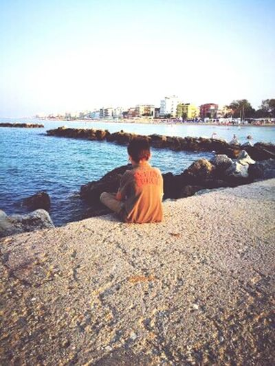 Beach Sea One Person Rear View One Man Only Adults Only Only Men Sky Water Adult Outdoors People Sitting Clear Sky Day Sand Relaxation Vacations Men Nature Children Romantic