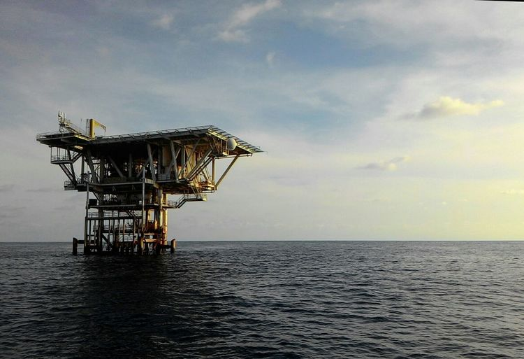 Drilling Rig In Sea Against Sky