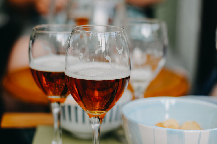 Beer Tasting Alcohol Aperitif Close-up Drink Drinking Glass Focus On Foreground Food Food And Drink Freshness Glass Glass - Material Household Equipment Indoors  No People Red Wine Refreshment Selective Focus Still Life Table Transparent Wine Wineglass