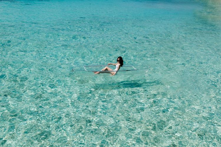Semporna 男仔很忙 NikonD810 Water Waterfront Sea Real People Leisure Activity One Person Swimwear Bikini Lifestyles Day Swimming High Angle View Beauty In Nature Nature Young Adult Turquoise Colored Women Young Women Outdoors