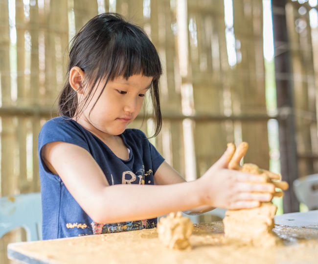 Excited Happy Long Hair Hand Dirty Wet Water Brown Abstract Sculpture Nature Art Handcraft Soil Artistic Expression Play Natural Organic Girl ASIA Chinese Kid Young Art Class Careful