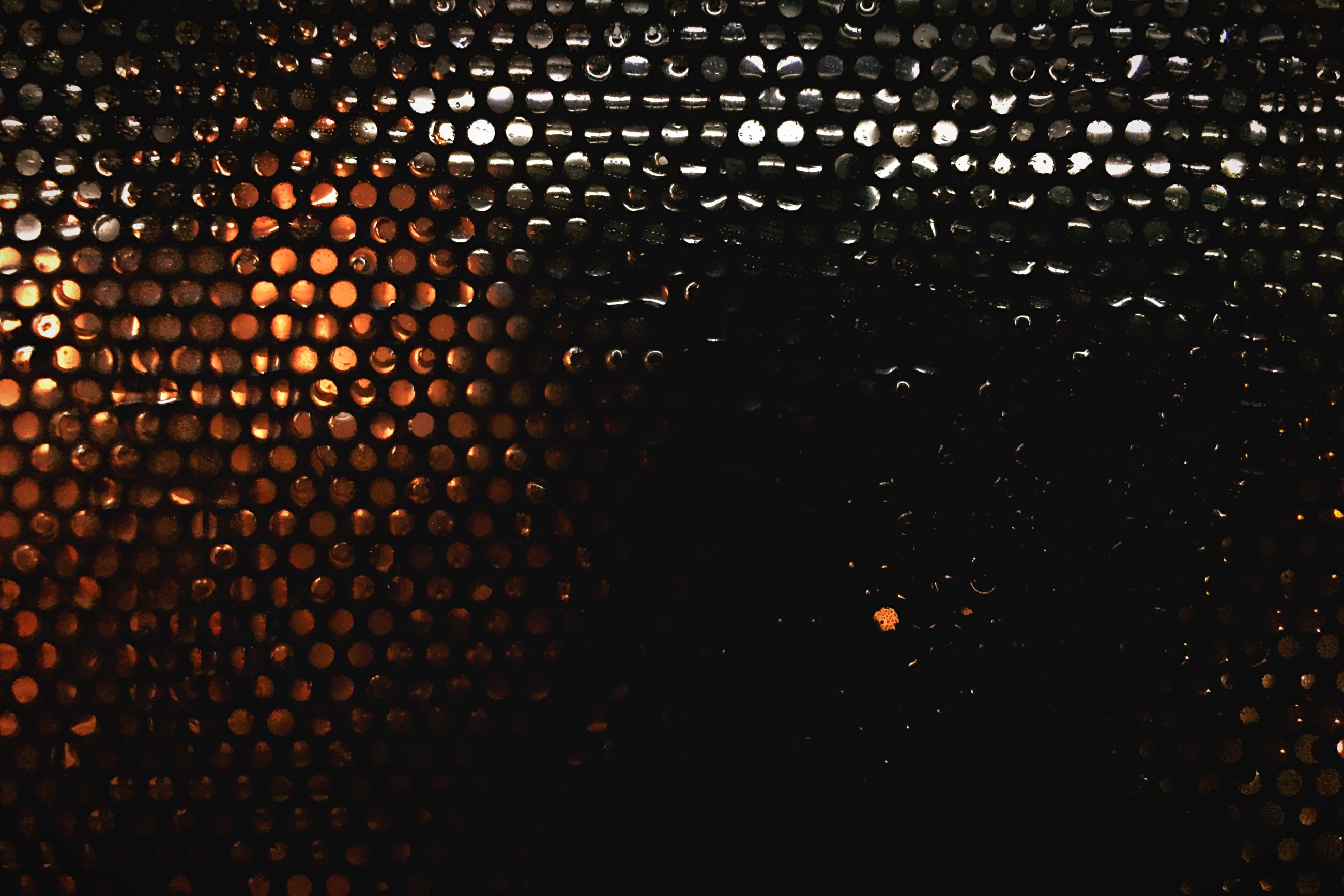 night, illuminated, indoors, full frame, dark, backgrounds, pattern, window, light - natural phenomenon, lighting equipment, glowing, no people, built structure, architecture, light, textured, close-up, glass - material, high angle view