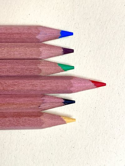 Pencil Writing Instrument Still Life Colored Pencil Art And Craft No People In A Row Multi Colored High Angle View Creativity Shadow Indoors  Close-up Arrangement Wood - Material Choice Variation Sunlight Red Textured