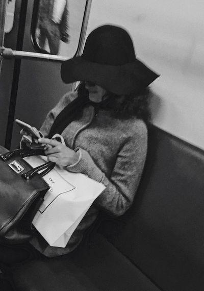 Дама в шляпе загадочность толпа обыденность метрополитен Люди Technology Sitting Real People One Person Indoors  Wireless Technology Computer