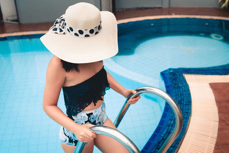 High Angle View Of Woman Wearing Hat At Swimming Pool