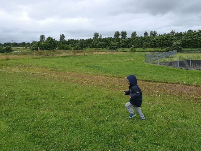 Boy Kid Child Running Playing Outdoors Park Jacket Casual Clothing Grass Fence Coat Hood
