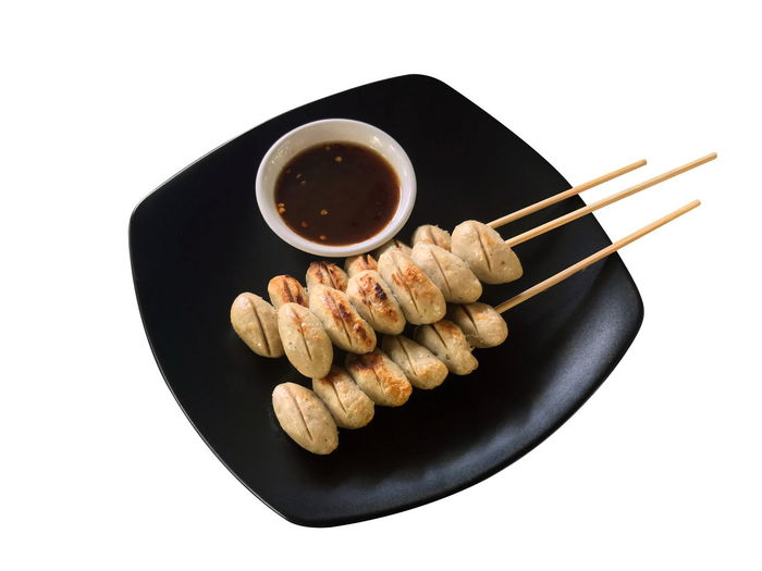 Meatballs grill and sauce in the black plate isolated White background Meat Balls Grill Asian Food Black Color Bowl Chopsticks Close-up Condiment Copy Space Cut Out Food Food And Drink Freshness Group Of Objects High Angle View Indoors  Japanese Food Meat Balls No People Ready-to-eat Sauce Snack Soy Sauce Still Life Studio Shot White Background