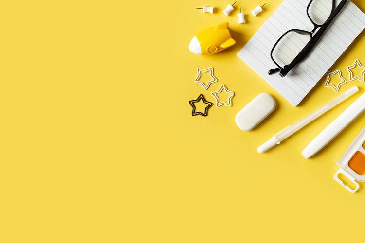 High angle view of yellow pencils on table