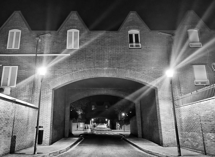View of empty illuminated street lights in tunnel