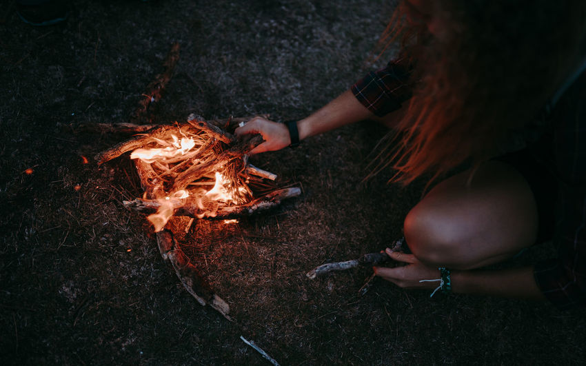 High angle view of woman holding bonfire