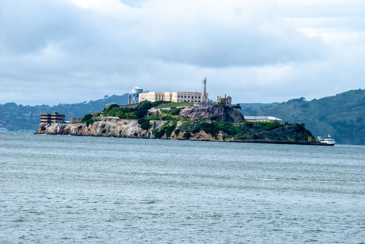 Sea Water Architecture Built Structure Building Exterior Building Land Cloud - Sky Mountain Sky Nature Beach Day No People Scenics - Nature Island Waterfront History The Past Outdoors Bay Passenger Craft Alcatraz Alcatraz Island