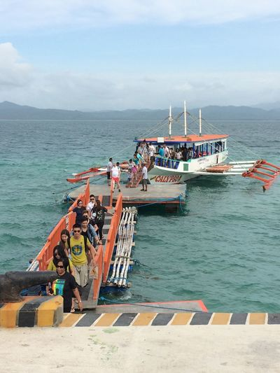 Sirs / Ma'am's, welcome to Dos Palmas Island Resort & Spa! Sea Water Real People Outdoors Large Group Of People Dos Palmas Day Mode Of Transport Horizon Over Water Puerto Princesa City Palawan Philippines Traveling Home For The Holidays Finding New Frontiers
