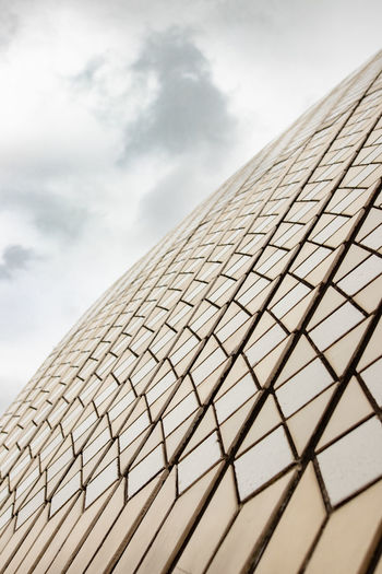 Sky Cloud - Sky Nature Pattern Low Angle View No People Close-up Day Built Structure Architecture Outdoors Protection Modern Sunlight Building Exterior Security Roof Design Shape Directly Below Sydney Opera House Opéra Structure Tiles