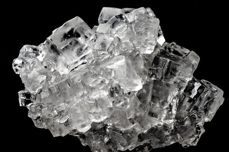 Cubic salt crystal aggregate against black background, isolated Black Background Isolated Aggregate Black Background Close-up Crystal Cubic Gemstone  Geology Halite Mineral No People Quartz Salt - Mineral Studio Shot