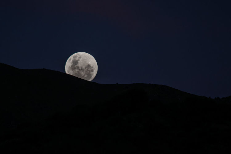 Night Sky Moon Astronomy Space Beauty In Nature Scenics - Nature Nature Tranquil Scene Tranquility No People Planetary Moon Mountain Copy Space Low Angle View Idyllic Silhouette Clear Sky Outdoors Full Moon Dark Eclipse Moonlight It's About The Journey