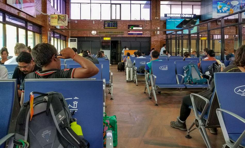 Adult Airport Departure Area Airportphotography Animal Themes Architecture Built Structure Group Of People Incidental People Indoors  Leisure Activity Lifestyles Men Mode Of Transportation Passenger People Public Transportation Real People Rear View Seat Sitting Transportation Travel Waiting Women