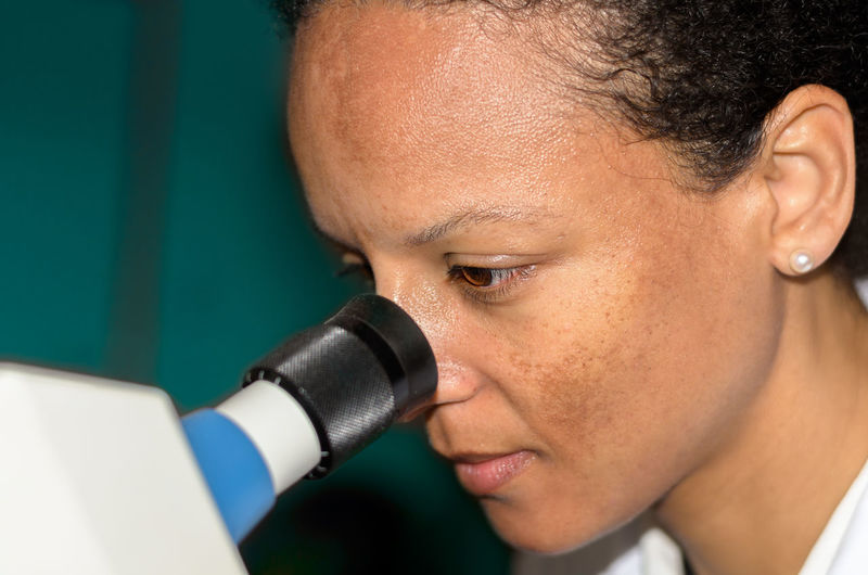 Woman looking into eye test equipment