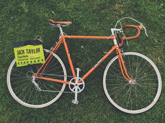 An orange 1950's Jack Taylor road bike laying on the grass with the original yellow matching musette bag Compagnolo Jack Taylor Jack Taylor Cycles Orange Road Bike Stockton On Tees Vintage Bike Bicycle Brooks Cycling Fixie Grass No People Old School Bike Bike Orange Bike Outdoors Retro Bike Road Bike Road Cycling York Cycle Show