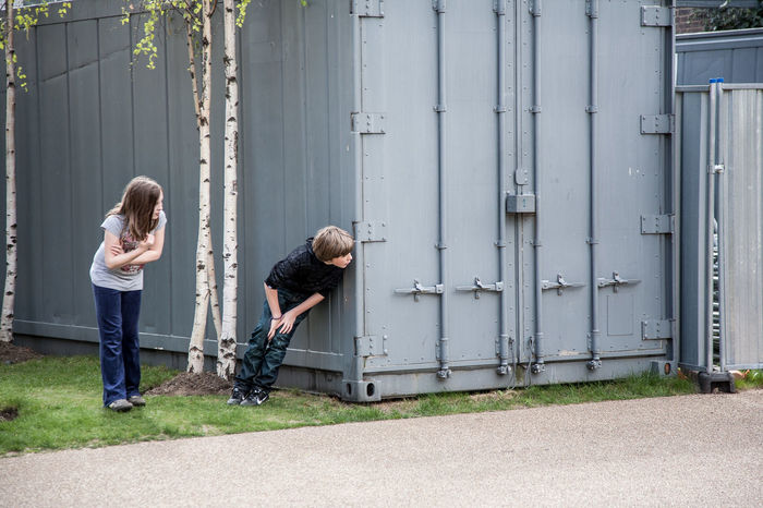 Street scene near Tate Modern gallery, London, UK Birch Boy And Girl Building Exterior Childhood Container Day Family Friendship Hidden Hide And Seek Kids Kids Playing Leisure Activity Lifestyles London London Lifestyle Outdoors Peeking People Playing Street Photography Streetphoto Streetphotography Tate Modern Togetherness