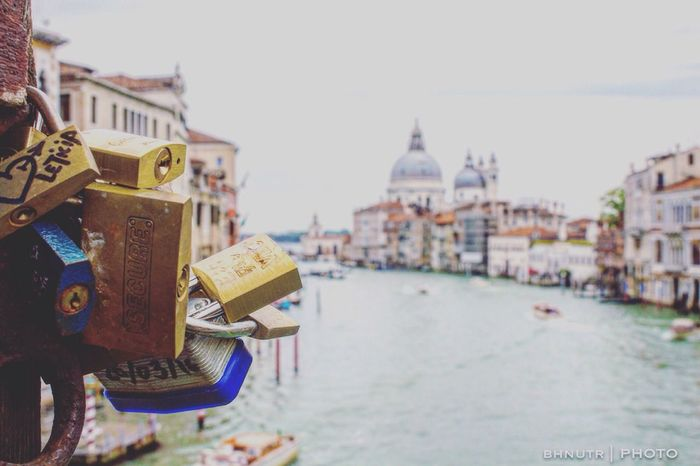 Architecture Built Structure Building Exterior Water Focus On Foreground Waterfront River Padlock Bridge - Man Made Structure Bridge Travel Destinations Luck City Life Outdoors Canal Cloud Sky Day Tourism Symbol Venice, Italy Venezia Venice Landscape Scenics Finding New Frontiers