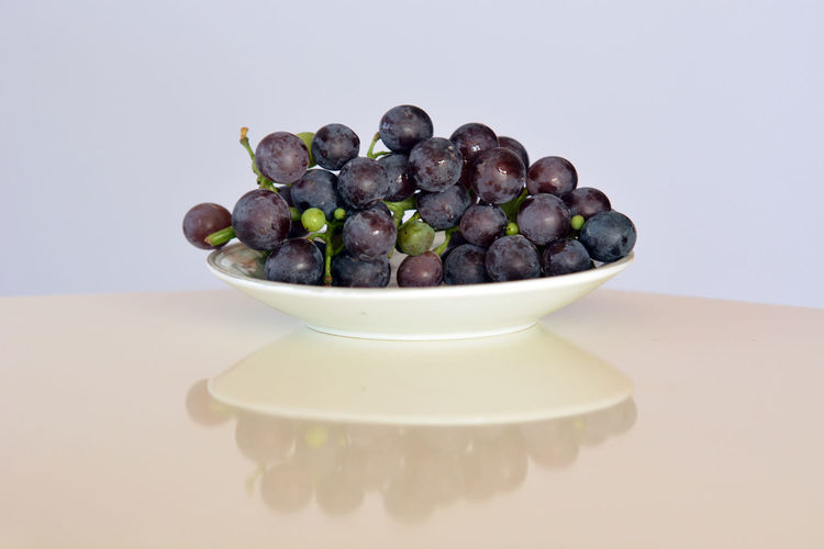 Berry Fruit Black Color Blueberry Bowl Close-up Copy Space Food Food And Drink Freshness Fruit Grape Healthy Eating Indoors  Large Group Of Objects No People Purple Still Life Studio Shot Table Temptation Wellbeing White Background