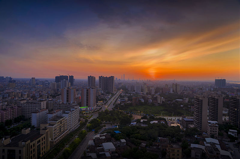 High angle view of modern buildings against sky during sunset