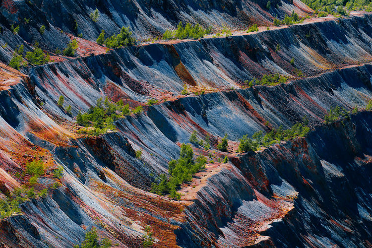 Full frame shot of rock formations in quarry. copper and gold mine