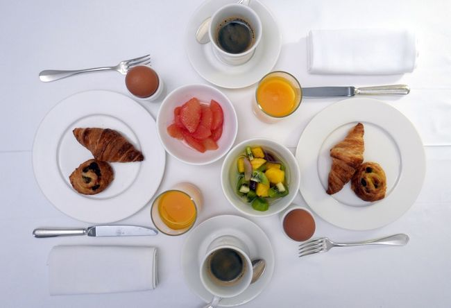 Table set with breakfast ready for two persons at the hotel France Breakfast Viennoiserie At The Hotel Having Breakfast Croissants Meal Set Table The Foodie - 2015 EyeEm Awards Time For Breakfast