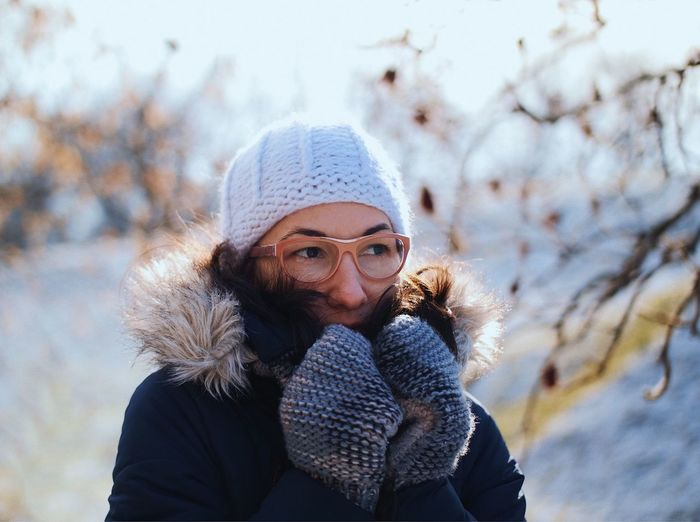 Close-Up Of Woman In Warm Clothing Against Sky