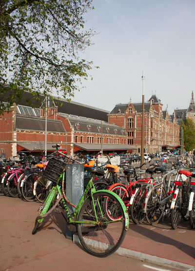 Bicycles parked in the bicycle racks outside Amsterdam Railway Station, Nederlands Amsterdam Amsterdam Railway Station Cycle Green Netherlands Architecture Bicycle Bicycle Rack Bike Building Exterior Built Structure City Day Dutch Environmentally Friendly Holland Land Vehicle Mode Of Transport No People Outdoors Sky Stationary Transportation