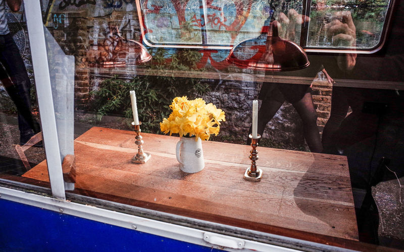 a place for 2 Candles Home Sweet Home Postcode Postcards Reflection Sidewalk Boat Everybodystreet Flower Flowers Freshness Glass - Material Looking Through Window Streetphotography Vase Window Window Sill Windows