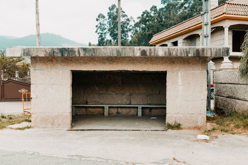LOST IN GALICIA 🚌 Lostingalicia Threeweeksgalicia Bus Stop Architecture Built Structure No People Day Nature Outdoors Plant Tree Building Exterior Building Old Residential District House Window City Footpath Entrance Abandoned Staircase Street