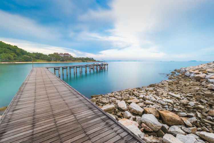 Wooden pier Wooden pier in Khao Laem Ya-Mu Ko Samet National Park, Rayong, Thailand Rock Thailand Beauty In Nature Bridge Cloud - Sky Day Nature No People Ocean Outdoors Pier Resort Scenics Sea Sky Stone Tranquil Scene Tranquility Water Wood - Material