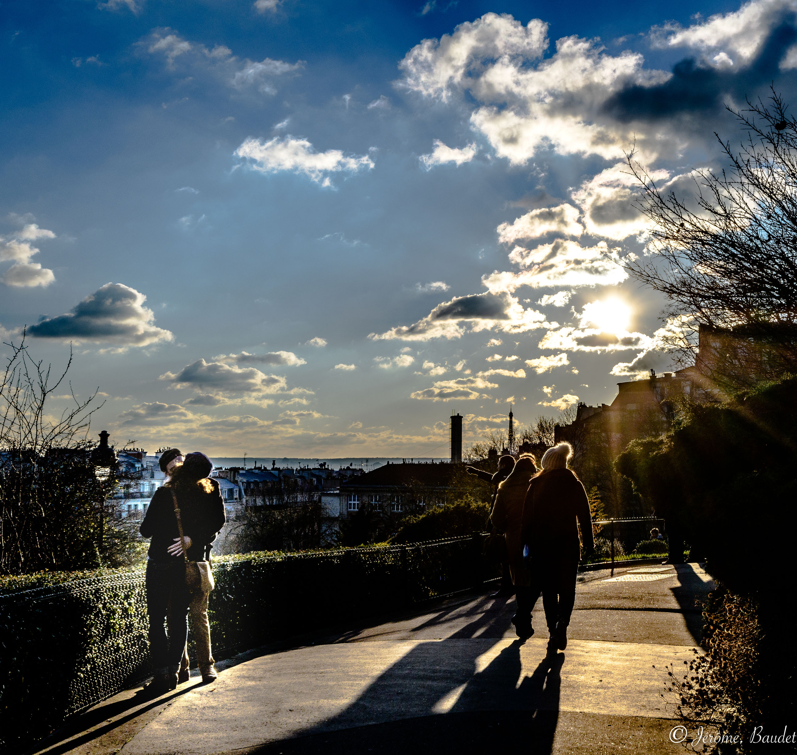 sky, cloud - sky, real people, transportation, sunlight, lifestyles, rear view, walking, group of people, nature, leisure activity, full length, people, men, city, women, road, the way forward, architecture, street, outdoors