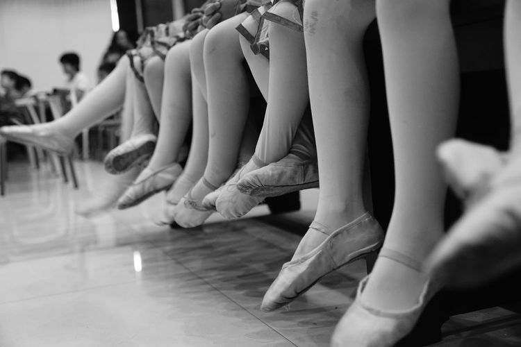 the kids when they were waiting for their stage Ballet Ballet Dancer Childhood Close-up Day Human Body Part Human Hand Human Leg Indoors  Leisure Activity Lifestyles Low Section Medium Group Of People People Real People Sitting Togetherness Women