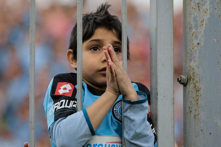 Belgrano EyeEm Gallery EyeEmNewHere Pray Belgrano De Córdoba Boy Cabalas Day Elementary Age Fan Futbol One Person Outdoors Praying Soccer Soccer Fans Tensed