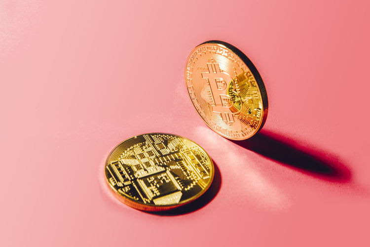 Close-up of coin against colored background