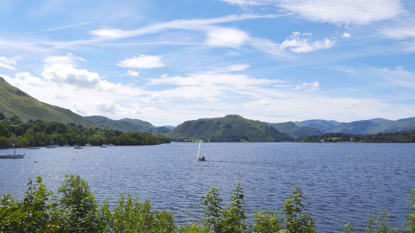 Lake Ullswater Cumbria Area Of Outstanding Natural Beauty Blue Lake Blue Sky White Clouds Ullswater Ullswater Lake Beauty In Nature Blue Boat Boat On Lake Lake Lake Ullswater Mountain Mountain Range Mountains In Background Sailboat Tranquil Scene Tranquility Ullswater, Lake District, Vacations
