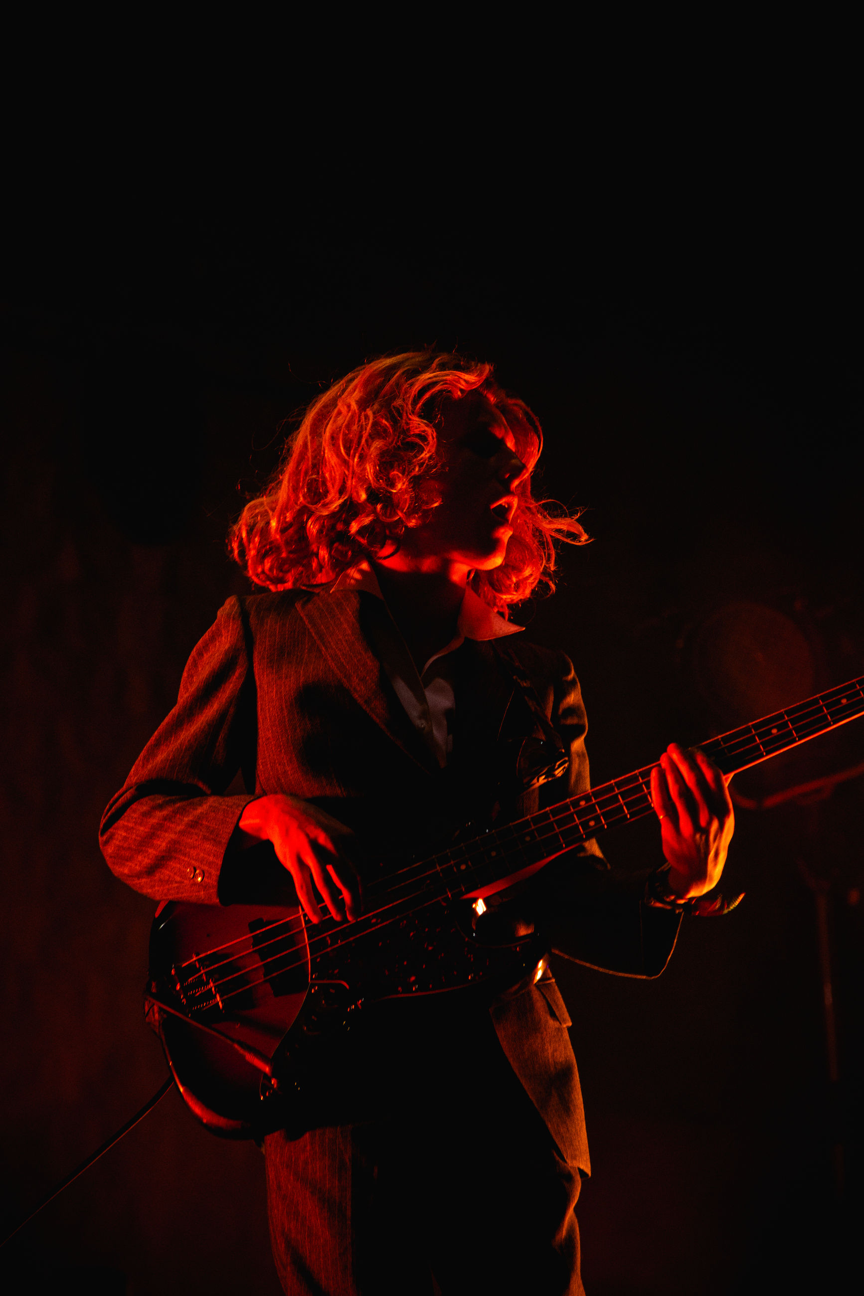 musical instrument, music, arts culture and entertainment, string instrument, playing, musical equipment, performance, guitar, artist, musician, one person, skill, real people, event, stage, stage - performance space, guitarist, night, holding, nightlife, concert, popular music concert, entertainment occupation, rock music, electric guitar, black background