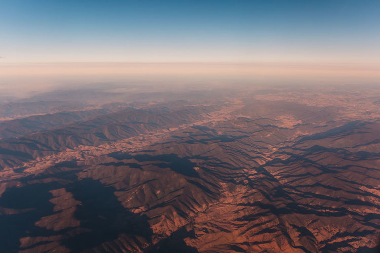 Aerial Scenics - Nature Environment Landscape Beauty In Nature Aerial View Tranquil Scene Sky Mountain Tranquility No People Non-urban Scene High Angle View Nature Mountain Range Outdoors Land Day Remote Physical Geography Idyllic Dramatic Landscape View Into Land Arid Climate