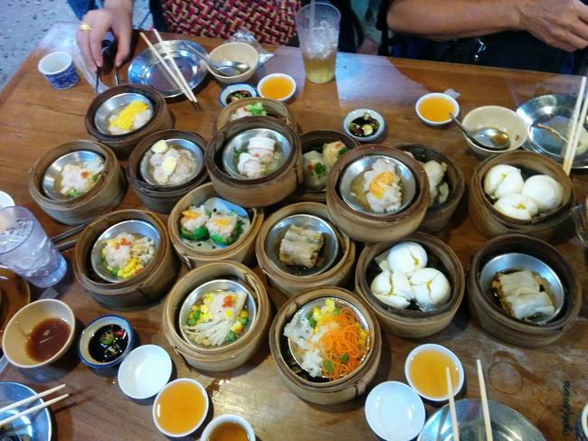 Adult Bowl Chinese Dumpling Chinese Food Chopsticks Day Dim Sum Dumpling  Egg Yolk Food Food And Drink Freshness Healthy Eating High Angle View Human Body Part Human Hand Indoors  Meal People Plate Ready-to-eat Real People Serving Size Soup Table