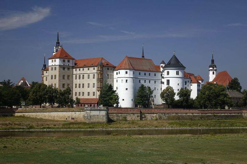 Schloss Hartenfels, Torgau Castle Historical Building Schloss Hartenfels Skyline Architecture Building Building Exterior Built Structure Castle Day Grass History Nature No People Outdoors Plant River Sky The Past Travel Travel Destinations Tree Water