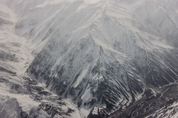 Full frame shot of snowcapped mountains during foggy weather at verbier