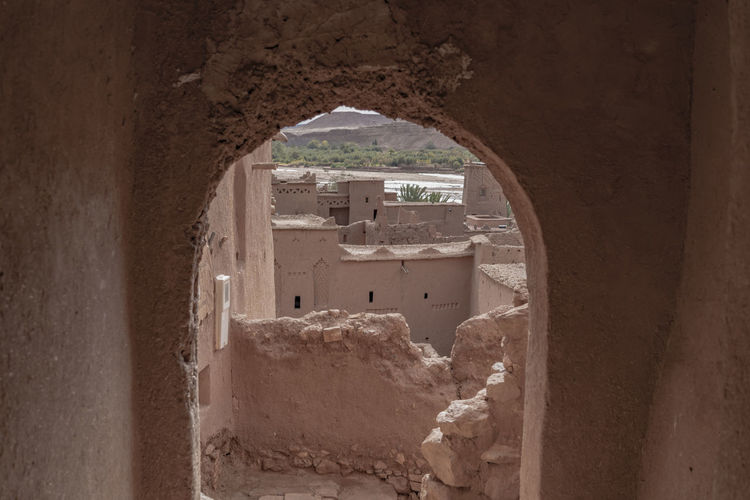 Architecture Built Structure Arch Wall - Building Feature History Old Wall The Past Hole Window Old Ruin Damaged Ancient Ancient Civilization Ruined Ruins Casbah Red Brick Archway North Africa Middle East Crumbling No People Building Looking Out